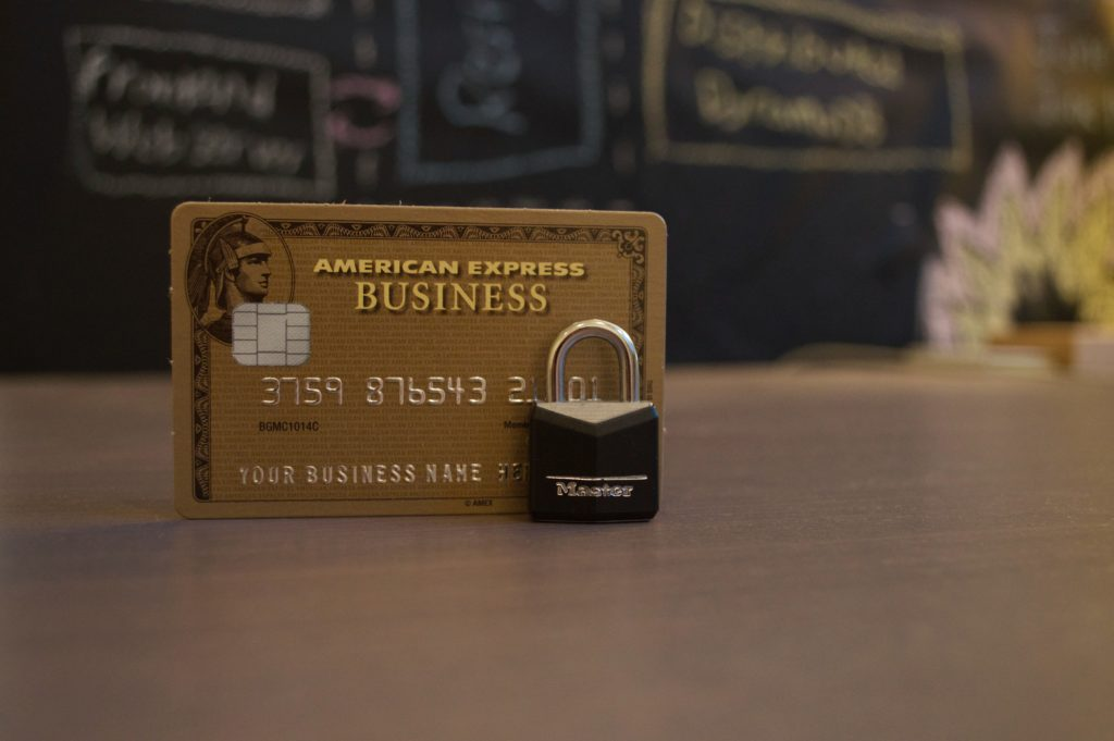 credit card and lock representing strong credit score