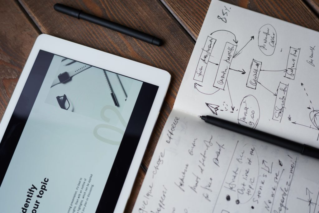 ipad and notebook with pen and notes