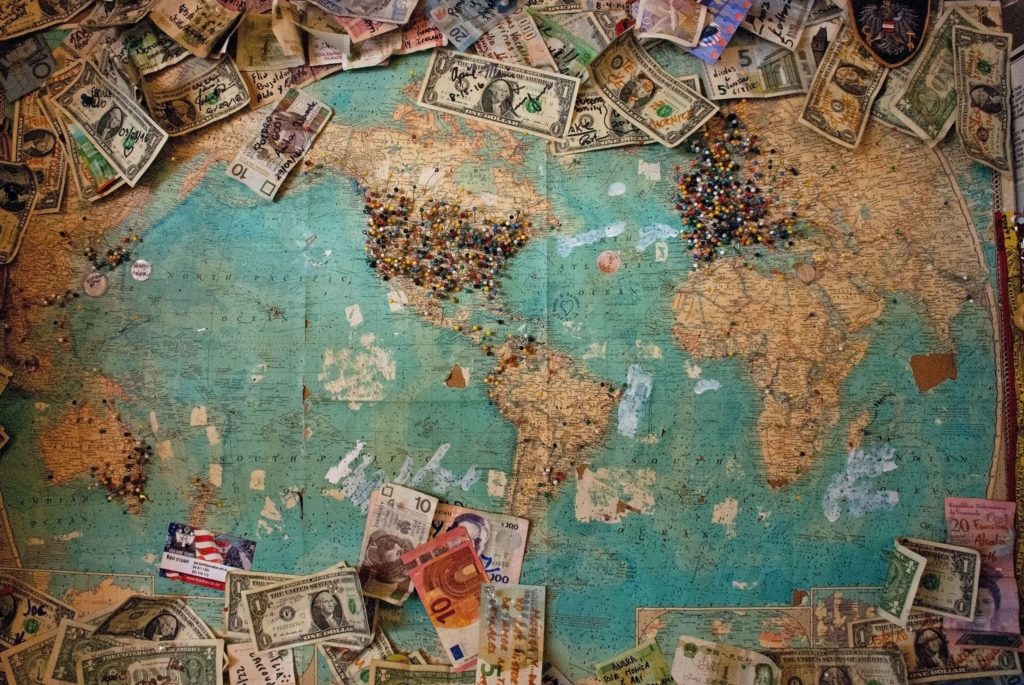 image of world map with different kinds of currency