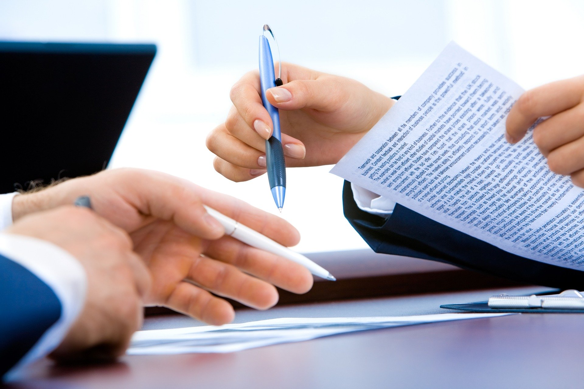 two people reviewing real estate documents