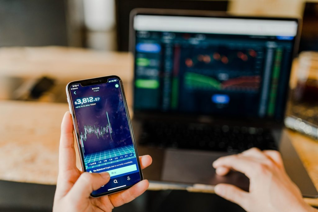 Stock Market on computer and iphone