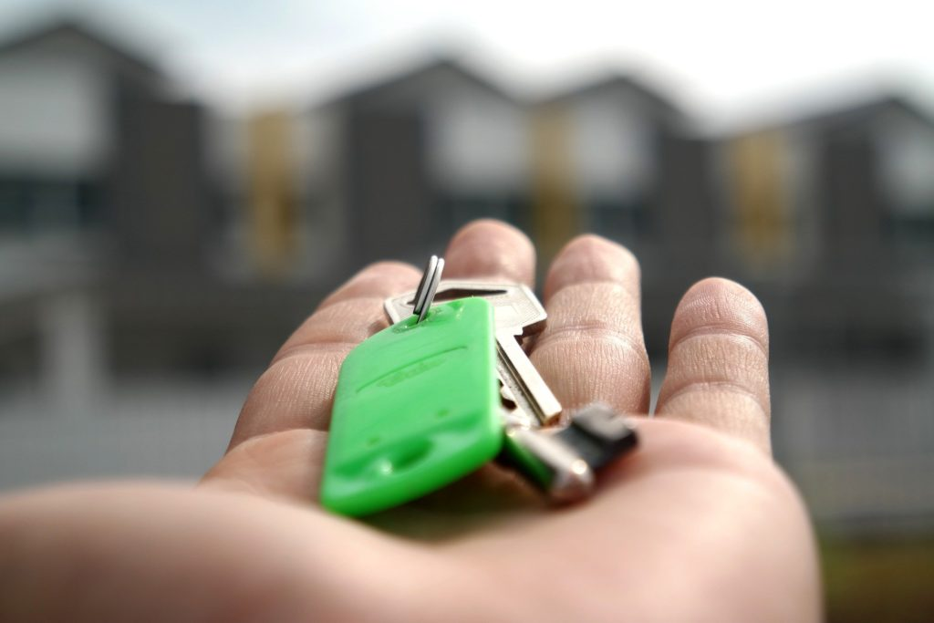 person holding key in hand